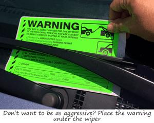 Parking violation sticker under windshield wiper