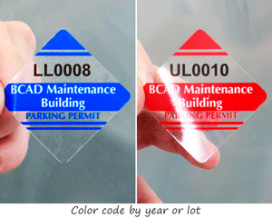 Color-coded parking permit stickers in a diamond shape