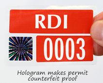 Hologram makes permit counterfeit proof