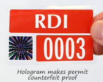 Hologram makes permit counterfeit proof
