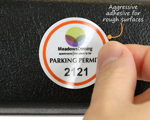 Mirror decals with aggressive adhesive