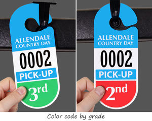 Parent pick-up mirror tag with school's name