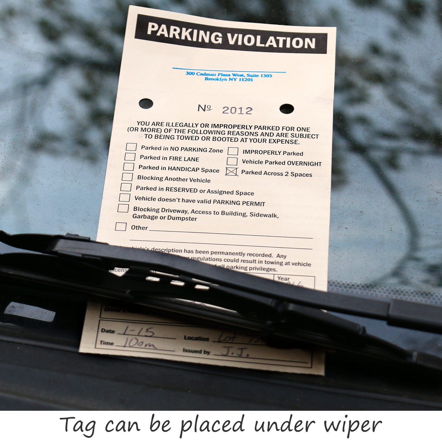 2 part parking violation ticket with numbers and perforation