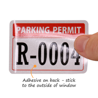 Reflective Parking Permits Outside of Car Window